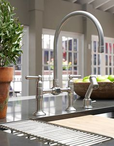 15. Consider sink inserts like Kohler's drying rack and cutting board. 16. Even the tallest pasta pot can fit under Kohler's HiRise faucet.