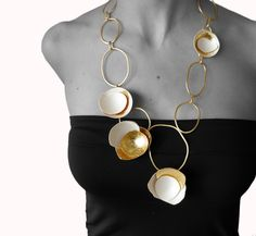 """des oeufs"" necklace, eggshell, gold foil, brass, jewellery by Maria Solorzano. on sale"