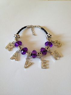 "Baltimore Ravens Football Inspired Beaded Purple Leather Adjustable Bracelet with Purple Beads with RAVENS Rhinestone Dangle Charms 8""-9"""