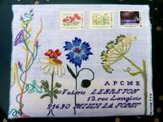 Embroidered envelope. Other pictures on the blog show the canceled stamps to prove it was successfully mailed. (Site is in French) http://bienvenuechezmamiejeannette.blogs.marieclaireidees.com/archive/2011/06/06/concours-art-postal-milly-la-foret.html