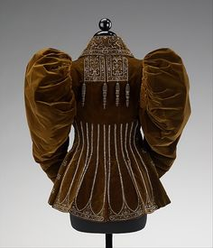 Afternoon jacket Design House: House of Worth  Designer: Attributed to Charles Frederick Worth  Attributed to Jean-Philippe Worth Date: 1895 Culture: French Medium: silk, beads Accession Number: 2009.300.75