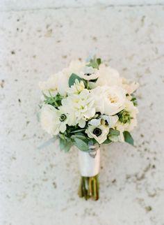 Anemone and peony wedding bouquet: Photography : Peter & Veronika | Event Planning : Il Cerimoniere Italian Weddings | Floral Design : Stiatti Fiori | Wedding Dress : Sweetheart Gowns | Venue : Villa La Selva Read More on SMP: http://www.stylemepretty.com/little-black-book-blog/2017/03/20/intimate-destination-wedding-in-tuscany-2/