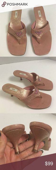 Prada pink & gold thong kitten heel sandals This is a beautiful authentic pair of Prada pink and gold metallic leather thong kitten heel sandals. Good preowned condition. Has somewhere to the outer Sole. Slight wear to the heel.  Otherwise beautiful condition. Please let me know if you have any questions Prada Shoes Heels