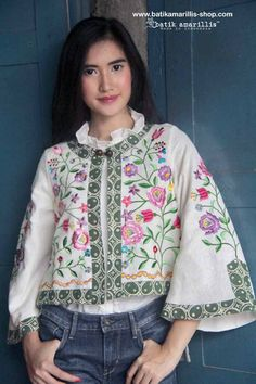 Batik Amarillis's Amarillissima jacket in Hungarian embroidery style on faux Suede .it's beautiful ,unique & special ,The style is vintage 1867's Victorian wardrobe inspired, the unique style & cutting of this beautifully tailored garment will turn heads with its captivating design.Available