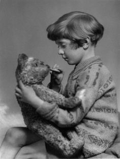 Christopher Robin was a real little boy and Winnie the Pooh was a real stuffed bear. The UK's National Portrait Gallery has many pictures of him as a young boy. Some of them include his father, A.A. Milne, the author of the Winnie the Pooh stories.