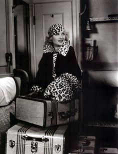 "This is a still from the brilliant screwball comedy ""Twentieth Century"" (1934) in which Carole Lombard, born Jane Alice Peters , plays a spoiled actress. Her leopard accented costume, and especially the fur muff, underline her sensual narcissism. Costumes by Robert Kalloch, uncredited."