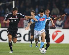 Marek Hamsik (C) of SSC Napoli competes for the ball with Mario Gomez (L) and Jerome Boateng of FC Bayern Muenchen during the UEFA Champions League Group A match between SSC Napoli and FC Bayern Muenchen at Stadio San Paolo on October 18, 2011 in Naples, Italy.