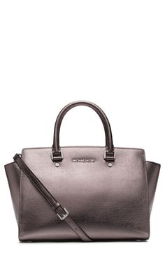 Free shipping and returns on MICHAEL Michael Kors 'Large Selma' Zip-Top Satchel at Nordstrom.com. A favorite of editors and fashionistas alike, the 'Selma' top-handle satchel is now available in shimmering metallic-hued styles that can easily transition from neutral to glam, depending on your ensemble. Scratch-resistant Saffiano leather and polished hardware provide fashionable elegance that stands the test of time, while slim rolled handles, an optional, adjustable shoulder strap, and a…