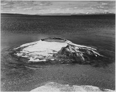 In the early twentieth century, the Fishing Cone of Yellowstone Park would routinely have 40 foot eruptions. As temperatures cooled, though, it has become more of a hot spring than a geyser. Photo by Ansel Adams.
