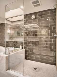 Really cool!  Love the shiny taupe tile and clean lines of the shower doors & white tub!
