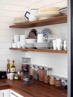 White cabinets, wood counter, open shelving, planked walls. . . for mini-kitchen?