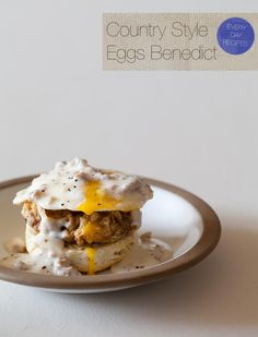 Country Style Eggs Benedict! Yum! Sausage gravy, biscuits and more...oh my! It's like a Southern pile up! Great recipe find!