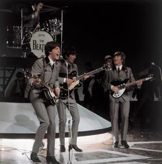 Paul McCartney, George Harrison, and John Lennon (Live on stage)