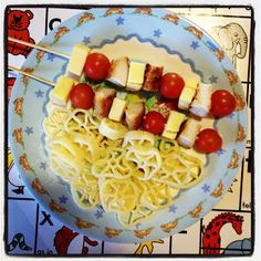 Chicken Schnitzel Cherry Tomatoes Cheese Cubes and Wheel Pasta with Butter