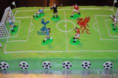 Soccer field cake with Liverpool and Totenham logo gel transfer