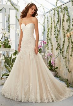 Strapless Tulle Wedding Gown with Dropped Waist Bodice Adorned with Alencon Lace Appliques