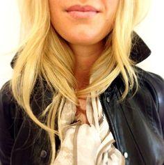 Blonde hair, black leather.