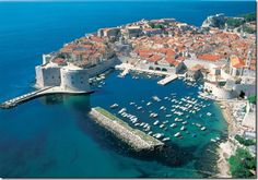 Dubrovnik is a city on the Adriatic Sea coast of Croatia, positioned at the terminal end of the Isthmus of Dubrovnik. It is one of the most prominent tourist destinations on the Adriatic, a seaport and the centre of Dubrovnik-Neretva county. Oh The Places You'll Go, Places To Travel, Places To Visit, Montenegro, Dream Vacations, Vacation Spots, Unique Honeymoon Destinations, Bósnia E Herzegovina, Croatia Travel Guide