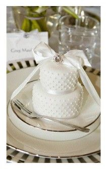 Individual mini-cakes are a fun treat for your guests.  Dream Wedding and Event Planners will assist you in locating the perfect cake designer.  Go to www.DreamWeddingPlanners.com.