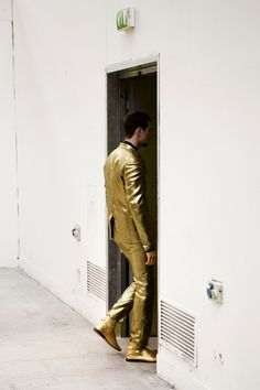 "Men's gold suit. In 1959 Elvis wore a gold suit on the cover of ""50,000,000 Fans Can't Be Wrong"" album"
