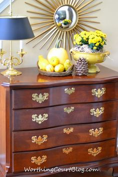 love the dresser in the entryway.... would be great to store mittens, gloves, scarves, hats, dog leash, umbrellas, etc.