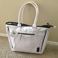 Puma Tote. NWT White with black trim. Super cool tote. Outside zipper, top zipper closure, inside zipper pocket and two inside pouch pockets Puma Bags Totes
