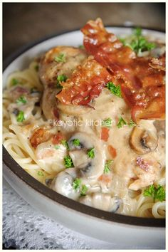 Country Club Chicken  Ingredients-  1 pound spaghetti  4 chicken breasts  1 large onion  7 oz mushrooms  1 can concentrated cream of mushroom soup  (1 Unox or 2 Campbell's)  4 or 5 slices bacon  1/4 cup dry white wine  2/3 cup sharp cheddar  1 apple  butter or oil  salt & pepper