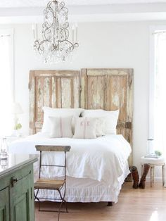 Instant headboard - just lean rustic, antique doors against the wall for an interesting focal point in the bedroom.