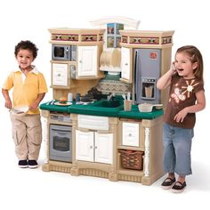 Create a home-like environment by adding a kitchen set! It promotes dramatic play and social interactions!  #kitchen #play