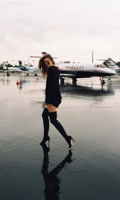 Gigi Hadid in a comfy black sweater and over the knee black boots | Pinterest…