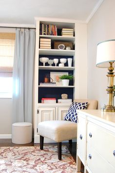 My new thoughts: Built-ins with navy painted back - room color Behr Wheat Bread - these are even the color of the current curtains I have