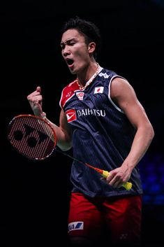 ODENSE, DENMARK - OCTOBER 16:  Kento Momota of Japan reacts in the Men's Singles first round match against Anthony Sinisuka Ginting of Indonesia on day one of the Denmark Open at Odense Sports Park on October 16, 2018 in Odense, Denmark.  (Photo by Shi Tang/Getty Images)