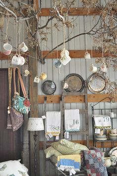 Hanging Tea cups from a tree. I think I can do this in the corner of my kitchen. :)