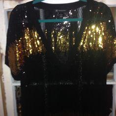 INC sheer v neck top Gold and black v neck sheet blouse. INC International Concepts Tops