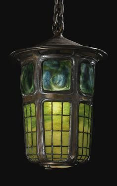 "TIFFANY STUDIOS  A RARE ""GEOMETRIC AND TURTLEBACK TILE"" LANTERN    leaded glass, favrile glass and patinated bronze    23 3/4 in. (60.3 cm) drop  10 in. (25.4 cm) diameter  circa 1905"