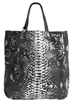 A carry-all denim tote with a fun vibrant pattern!