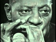 Check out the intro here.  What an entrance.  We could recreate this via silhouette for Sonny Boy - Case and Umbrella and Lid are classic.  Sonny Boy Williamson - Keep it to Yourself - YouTube