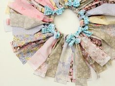 How To Make an Upcycled Tutu Using Fabric Scraps: Tie the new fabric strip in a bow around the tutu strip. Repeat on various tutu strips all around the top edge of the tutu. From DIYnetwork.com