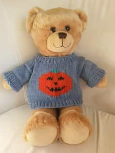 sewing teddy bear A cute pumpkin pattern for your bear made in stocking stitch throughout with a pumpkin motif at centre front. This is a very easy pattern for anyone new to intarsia and I've given a link for this technique. Teddy Bear Knitting Pattern, Knitted Teddy Bear, Crochet Teddy, Sweater Knitting Patterns, Baby Knitting, Teddy Bears, Knitting Ideas, Knitting Toys, Crochet Doll Clothes