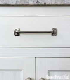 "'You can see the brushstrokes in the milk paint, which ""makes the cabinetry feel more casual."" Aubrey pull and knobs in satin nickel by Restoration Hardware. Kitchen Cabinet Hardware, New Kitchen Cabinets, Home Hardware, Kitchen Stove, Hardware Pulls, Cabinet Knobs, Milk Paint Cabinets, Painting Cabinets, Grey Kitchen Designs"