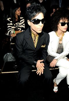 2011 In black sunglasses, a quiet black suit and gold shirt, Prince attends a Versace for H&M fashion show on November 8, 2011 in New York. | Billboard