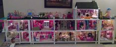 PERFECT!! Barbie House - to bad thered be no way to get it upstairs lol but this would be perfect for the amount of barbies she has =)