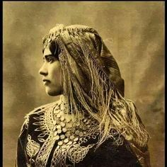 Beautiful Kurdish Girl in a traditional Dress, with a Headgear and Jewelry. Photo taken in 1902.