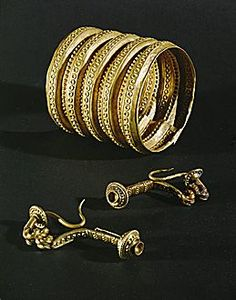 HALLSTATT CULTURE JEWELRY 6TH BCE  Gold bracelets and clasps from the tomb of a prince near Ludwigsburg, Germany.