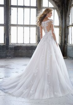Alençon Lace on Soft Tulle Ball Gown with Gored Insets. Removable Moonstone Beaded Net Belt Also Sold Separately as Style 11282.
