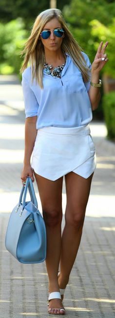 Shop this look on Lookastic:  https://lookastic.com/women/looks/long-sleeve-blouse-shorts-thong-sandals-tote-bag-sunglasses-necklace-watch/11781  — Blue Sunglasses  — Blue Necklace  — Gold Watch  — Light Blue Long Sleeve Blouse  — White Shorts  — Light Blue Leather Tote Bag  — White Leather Thong Sandals