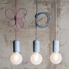 These minimalist concrete pendant lamps by Jakub Velinsky cast just the right light to keep winter's gloom at bay.