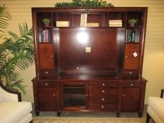 """Item #: 40314 A beautiful dark wood entertainment center. This unit measures 82"""" long x 20"""" deep x 80"""" tall and has a 52"""" wide opening in the middle for a TV. It's a nice, transitional piece."""