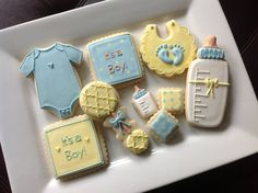 1 dozen baby shower cookies for a boy/ baby blue, yellow and tan/ quatrefoil print Fancy Cookies, Cute Cookies, Cupcake Cookies, Sugar Cookies, Cupcakes, Baby Boy Cookies, Baptism Cookies, Baby Shower Cookies, Chocolates