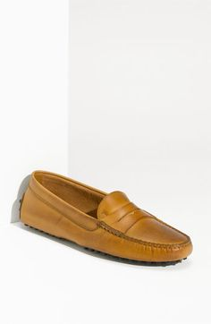 Free shipping and returns on Tod's 'Gommini' Driving Moccasin at Nordstrom.com. A classic driving moc designed with chic loafer styling is finished with a nubby rubber sole.
